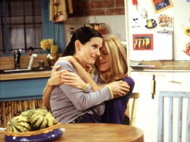 in photo the fictional due of monica and rachel sitting, hugging each other