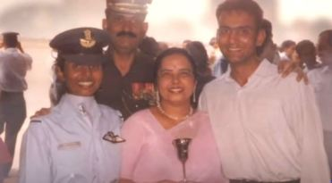 an old photo of gunjan saxena in uniform at the academy with her family- mother father and husband