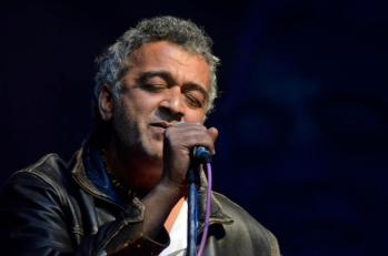 singer lucky ali singing holding a mic