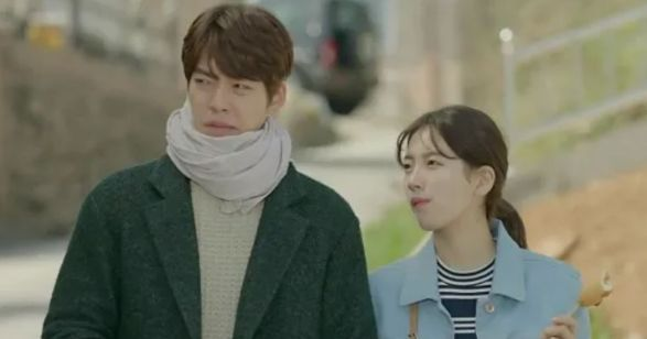 lead actors from the korean show Uncontrollably Fond in a still from the movie walking on the road