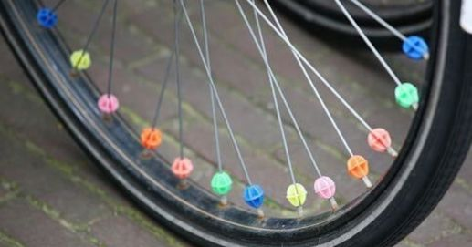 cycle with beads in the tire spokes
