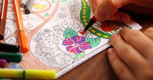 in photo a coloring book with colors