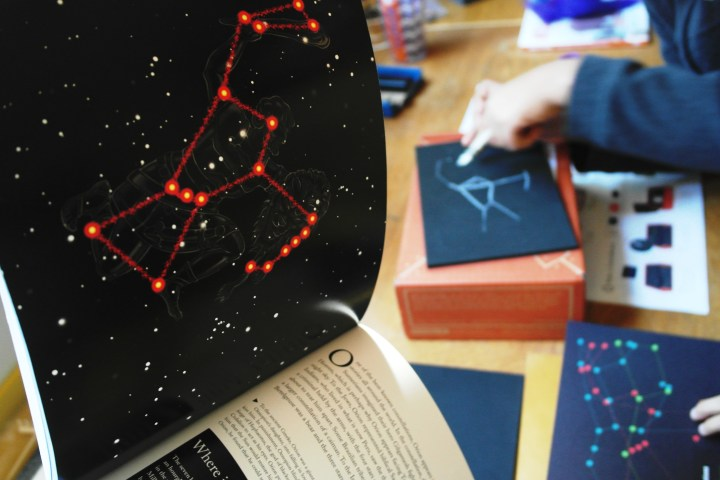 Then they used the provided white crayon and connected the dots. We decided to bring out my book of constellations to help with connecting the dots (this book is awesome, I highly recommend. Click on the picture to take you to the link.)