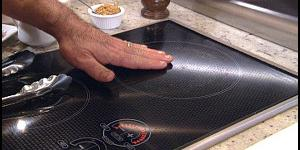 safely touching induction cooktop with bare hand