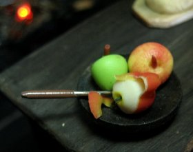 theinfill Medieval, Tudor, Jacobean dolls house blog - Hogepotche Hall –Hodgepodge Hall - main kitchen - fruit snack of pealed apple