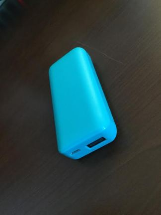 Portable charger side