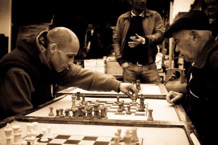 Men playing chess on Brick Lane