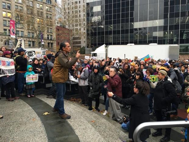 A speaker addresses the hundreds of demonstrators who met in lower Manhattan Thursday to protest the Dakota Access Pipeline.