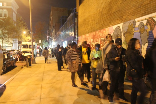 Washington Heights residents wait in line to vote at P.S. 153 Adam Clayton Powell School in the late hours of Election Day.