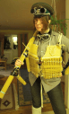 "You posing with a ""spaghetti gun"" and wearing a woven ""spaghetti-hunting jacket"". Spaghetti may be cooked or uncooked."