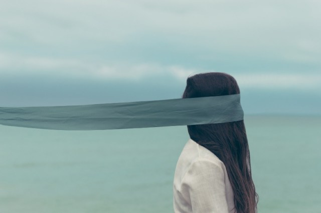 """""""Woman with long hair covered with a blue blindfold in Scarborough"""" by Oscar Keys"""