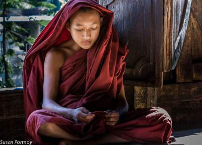 A young monk lost in thought during class at the Shwe Yan Pyay Monastery