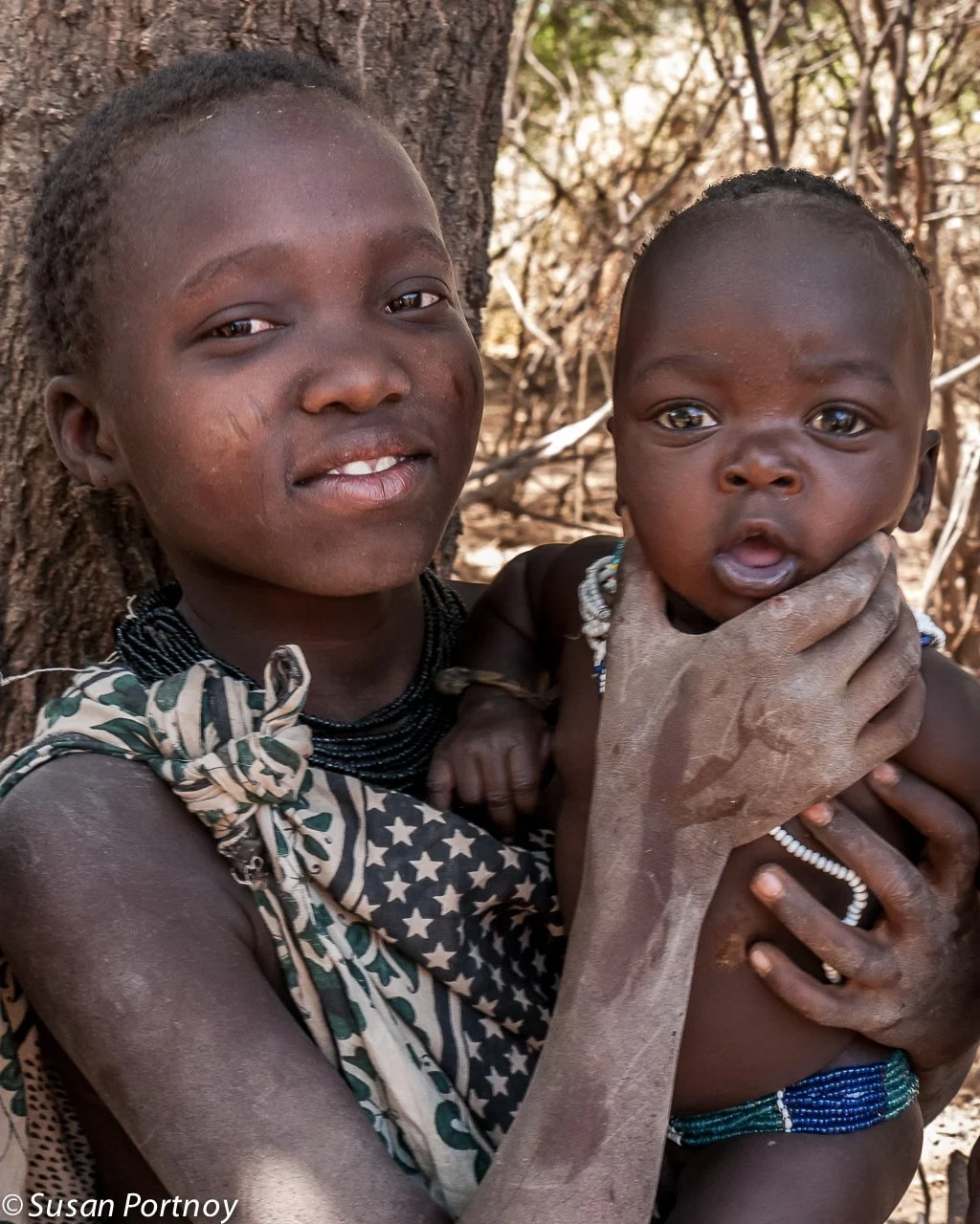 Young Hadzabe girl and baby #2