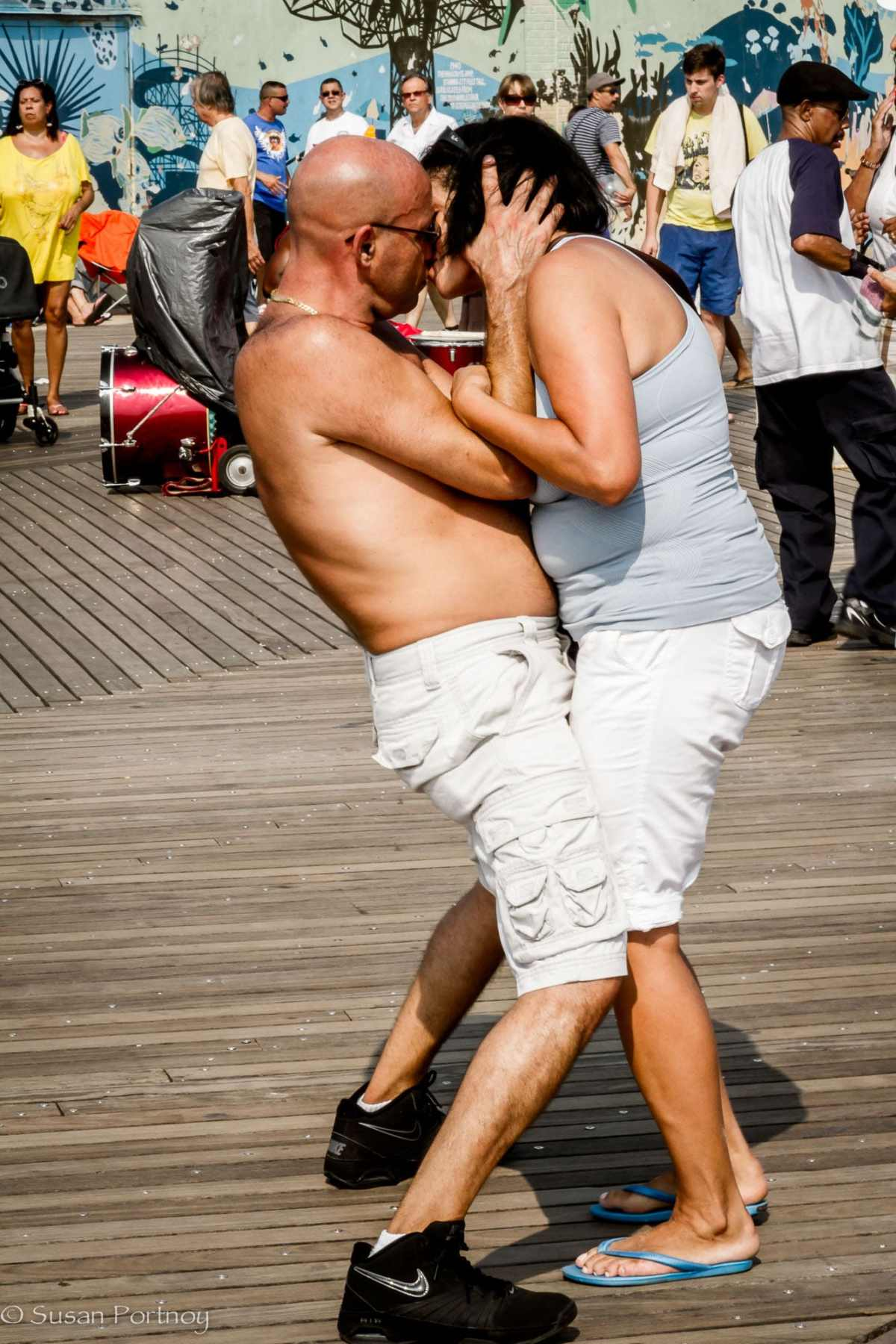 Two people kissing while dancing on Coney Island