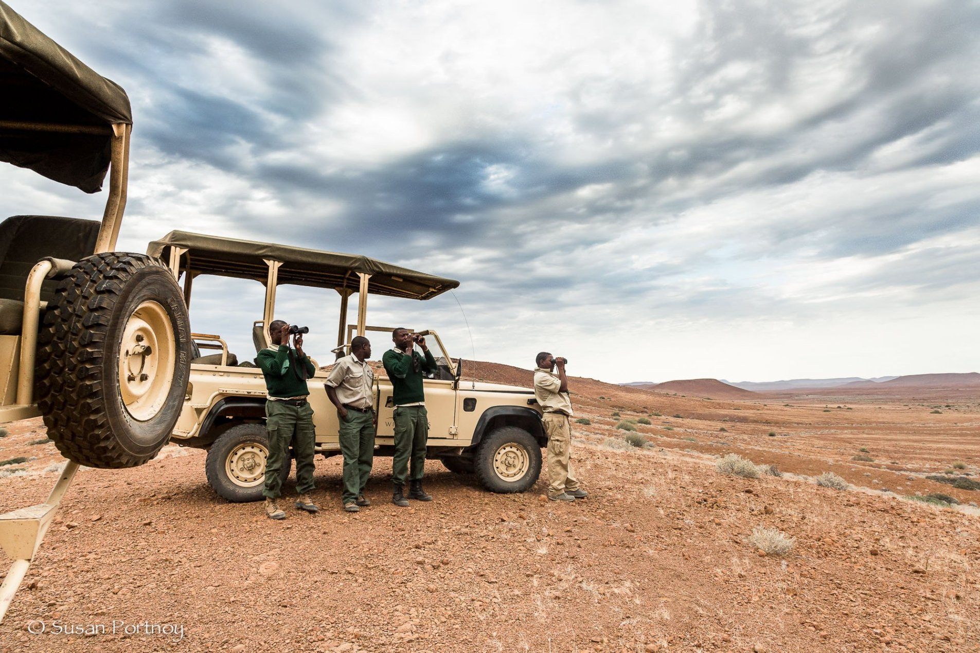 Three Save the Rhino Trust rangers and my guide Bons Roman looking for black rhino
