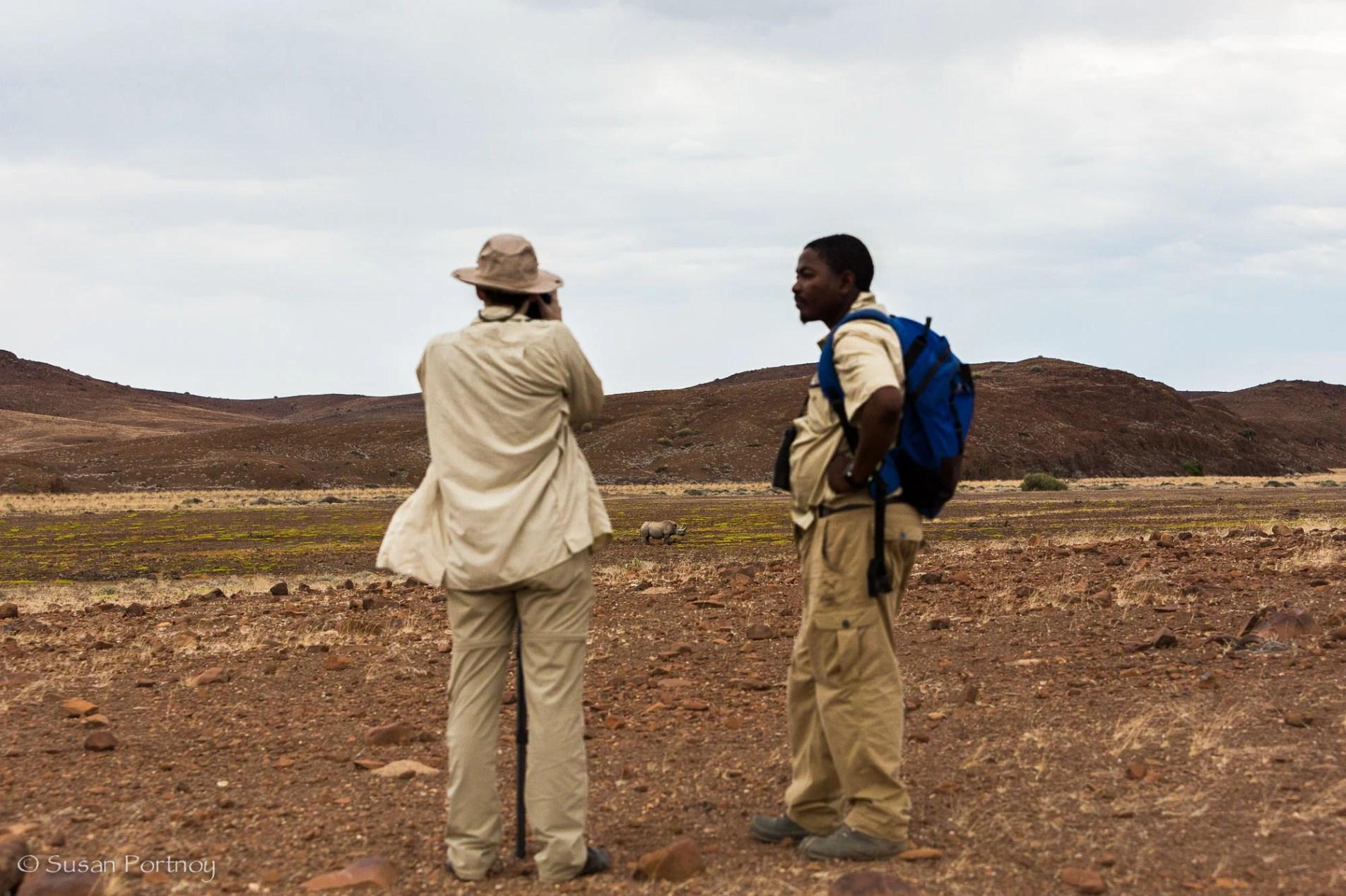 Susan Portnoy and Bons Roman photograph black rhino near Desert Rhino Camp, Namibia