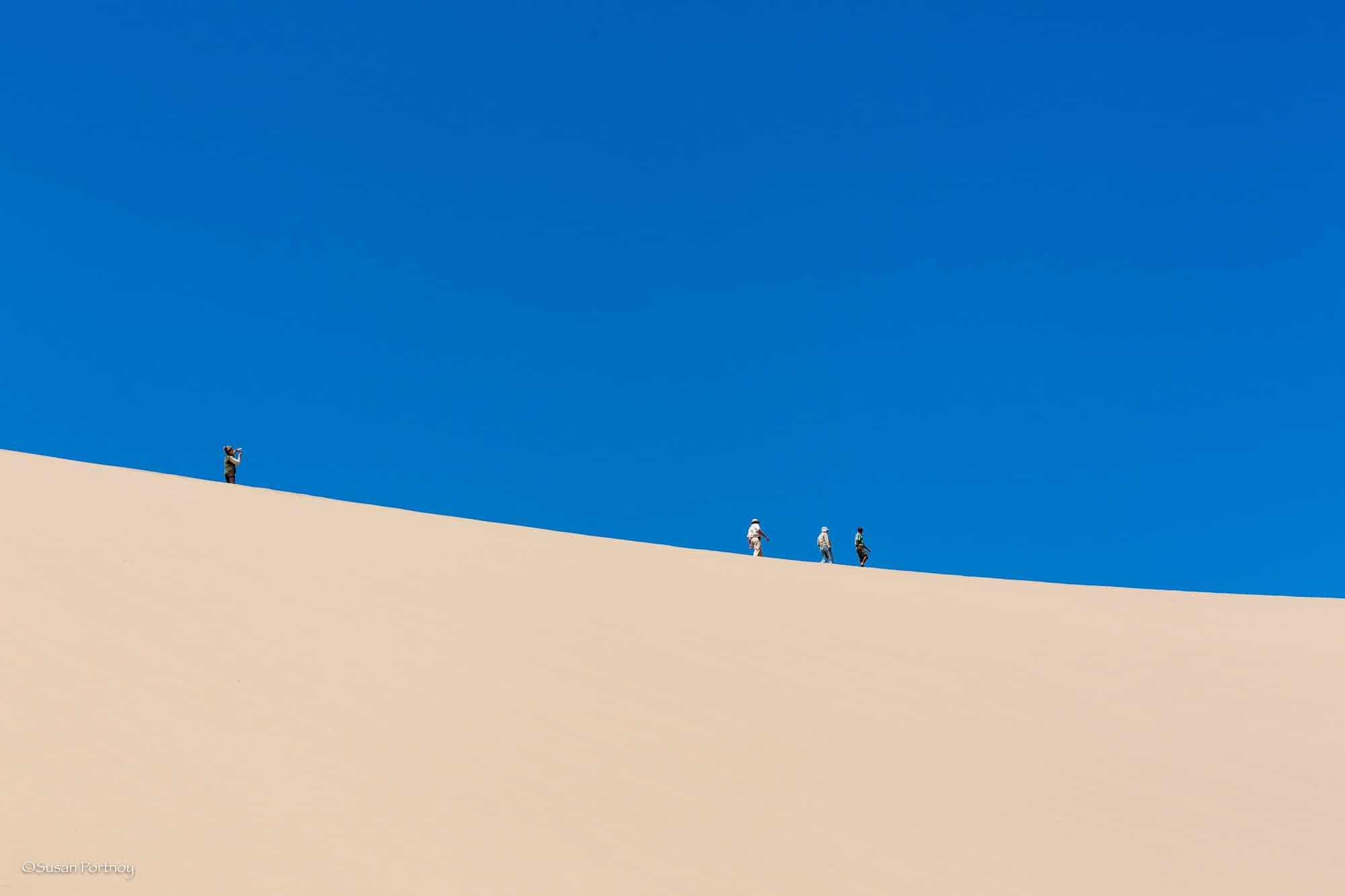 My fellow travelers atop the roaring dunes as they prepare to descend