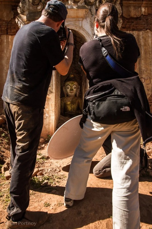 Students learning to use a reflector on a Photo tour in Myanmar