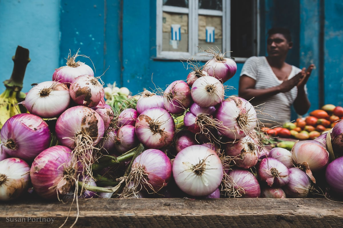 Man selling onions in Havana Central