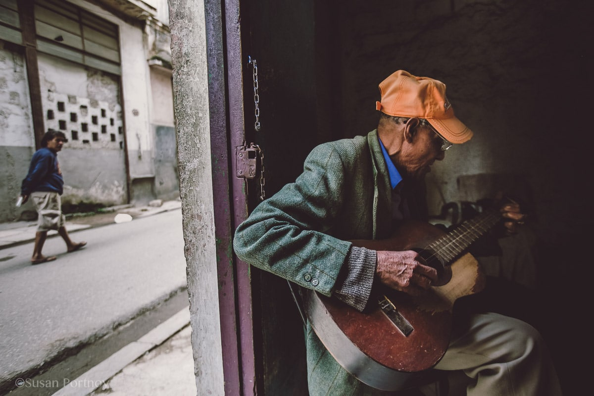 Local man in Havana, Cuba playing guitar