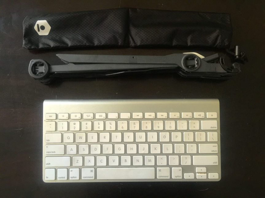 Collapsed Roost (middle), the pouch it comes with (top), my wireless keyboard