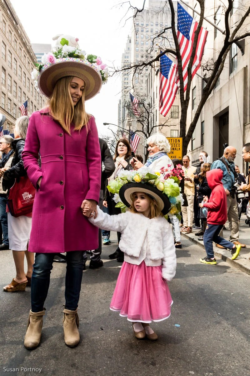 Woman and child wearing costumes at the Easter Parade New York City 2016