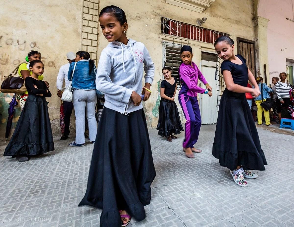 Photographing travel portraits of girls dancing in Havana, Cuba