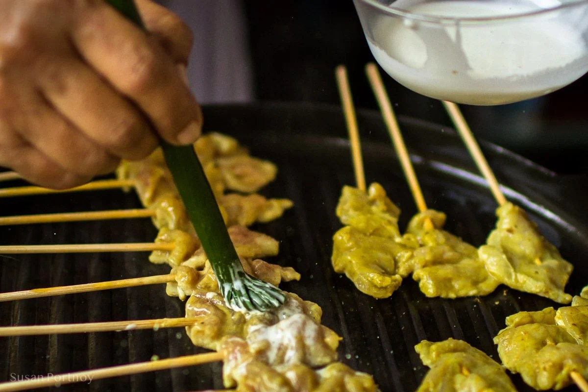 Cooking chicken Satay