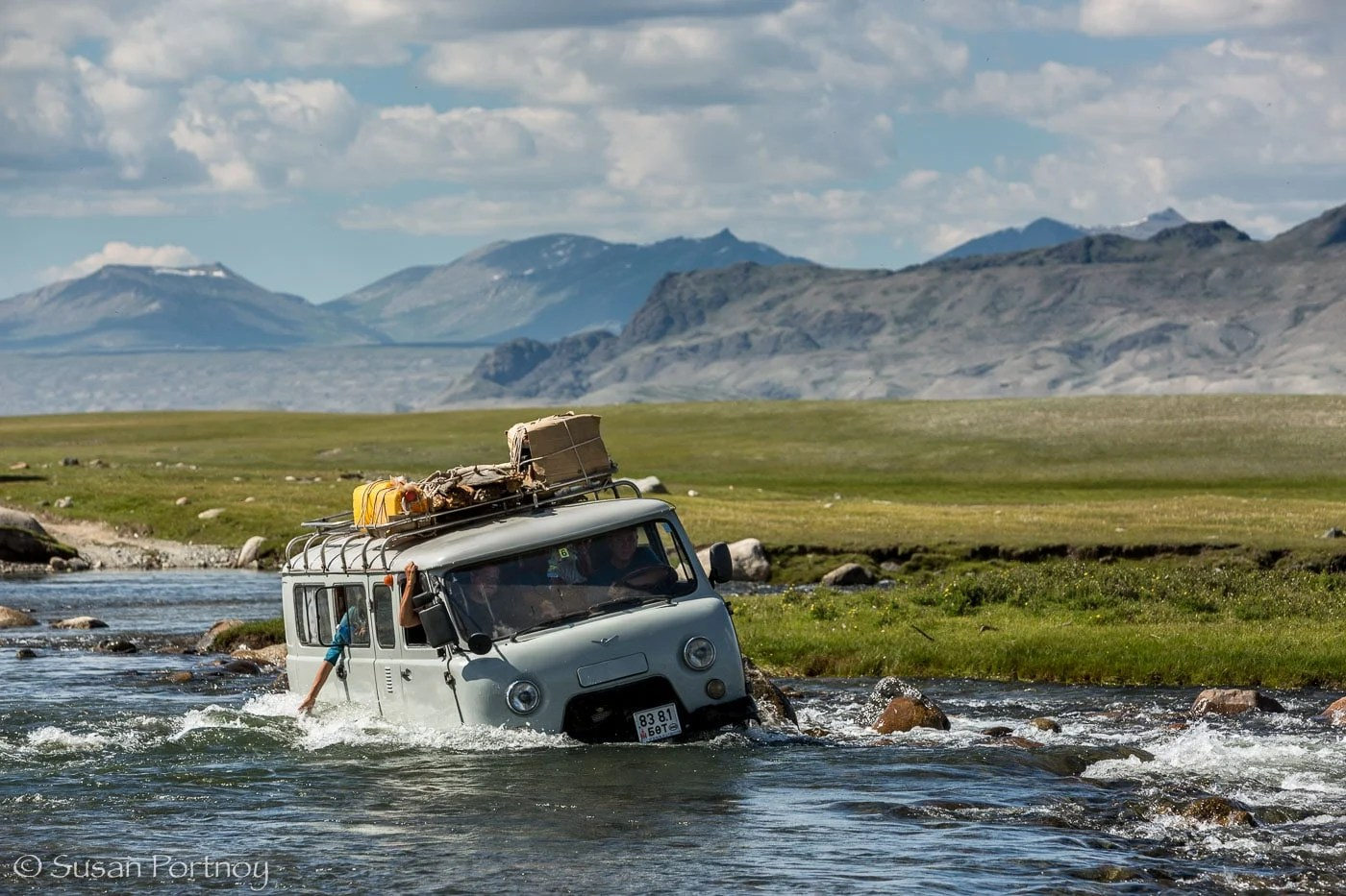 Russian van during a river crossing in Altai Tavan Bogd National Park, Mongolia