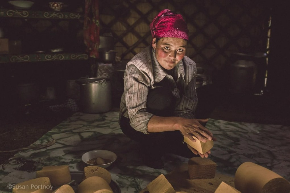 This Kazakh woman cut huge bricks of cheese Photographing Kazakh Nomads in Mongolia