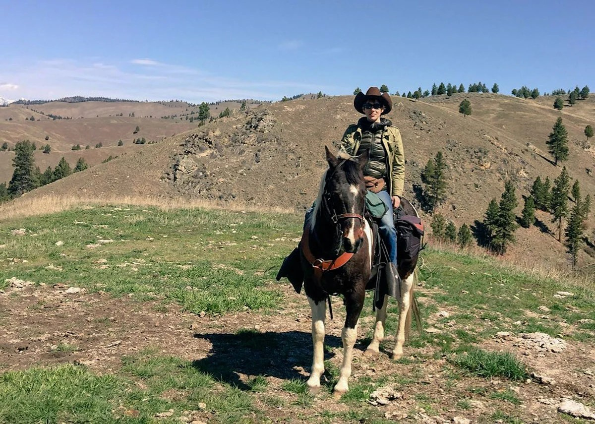 Susan Portnoy, the insatiable Traveler, horseback riding in Montana