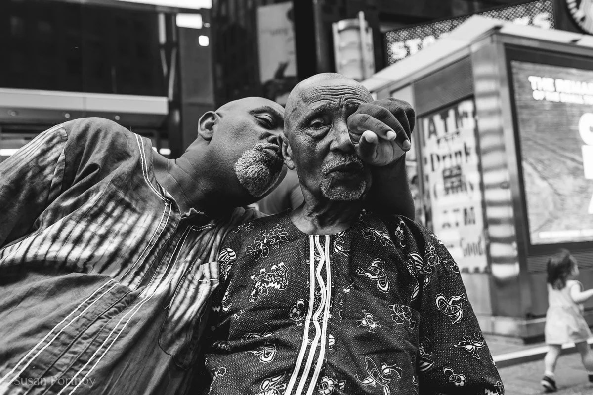 Two men in Times Square - Peter Turnley Street Photography Workshop