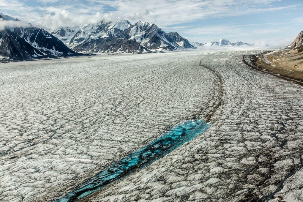 Turquoise meltwater stands out against the surface of the Kaskawulsh glacier
