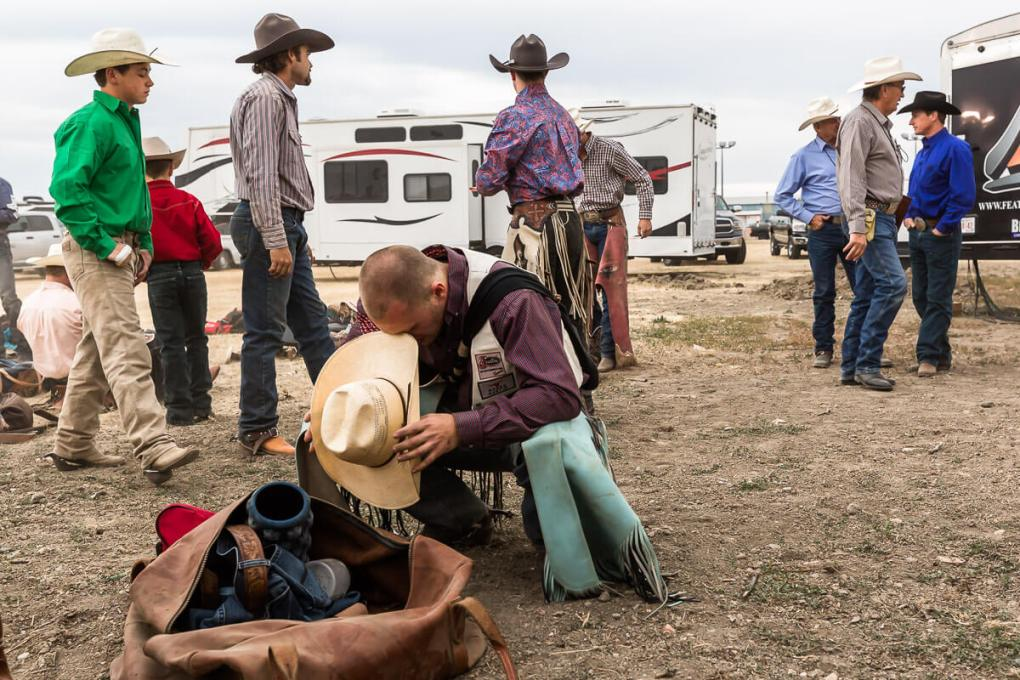 Cowboy prays before a rodeo