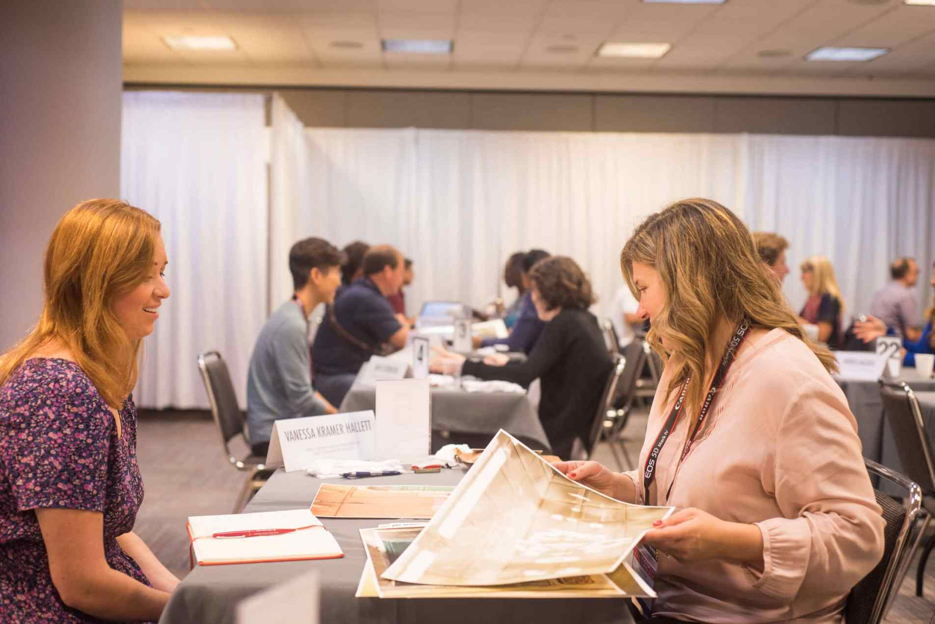 PPE Taking notes -Photo Plus Expo: X Reasons You Should go if You Love Photography