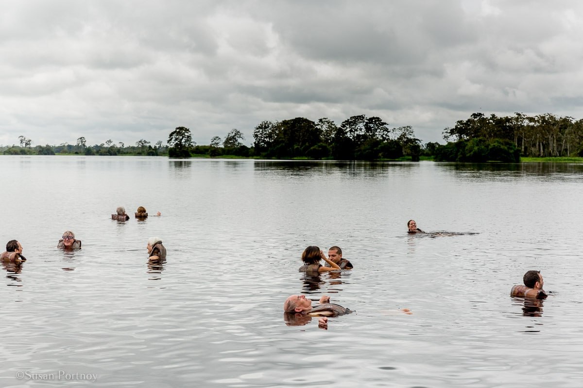 People swimming in a black water river | Amazon River Cruise Peru -International Expeditions-01-2