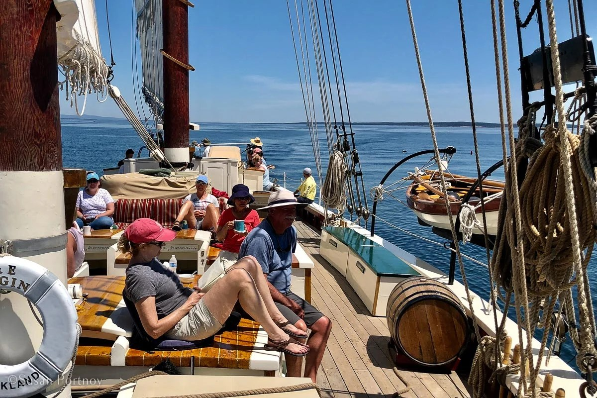Guests relax on the J & E Riggin on Penobscot Bay - Windjammer cruise in Maine-694220180704