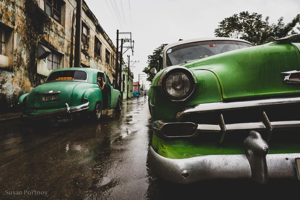 Two vintage cars in Bejucal, Cuba