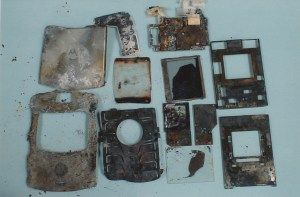 Exhibit-412-Burnt-Cell-Phone-Pieces-1024x674