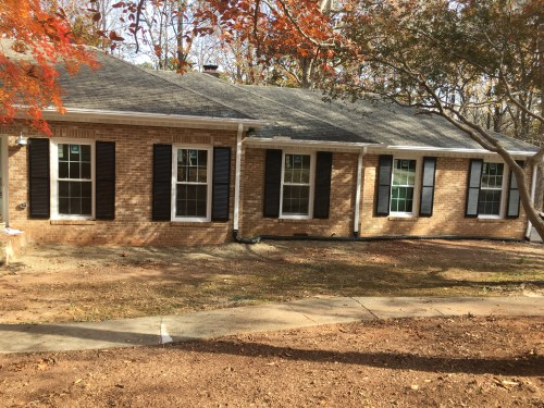 exterior brick ranch renovation raleigh before landscaping