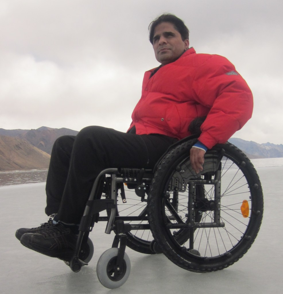 Navin Gulia in Mountain sitting on wheelchair