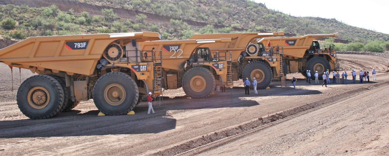 Caterpillar trucks line up at the company's test mine in Tinaja Hills, Arizona, US. Copyright: The Intelligent Miner