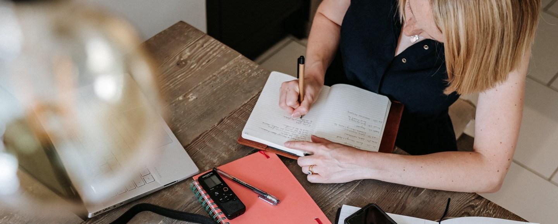 Carly writing. Image: Zoe C Photography