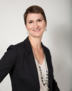 Karen Chovan stands against a grey background