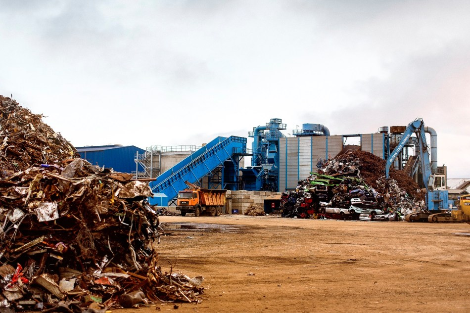 Photo showing scrap metal piles at a recycling plant