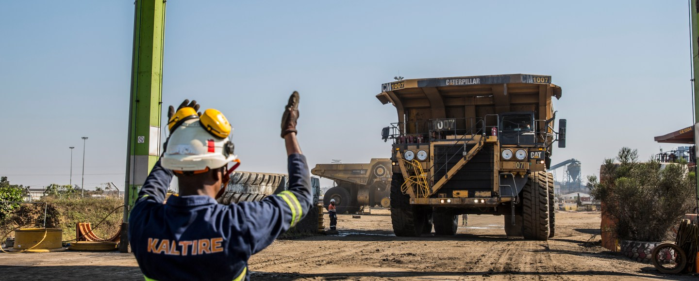 A mining truck pulls into a maintenance bay for inspection at a mine in Africa. Image: Kal Tire