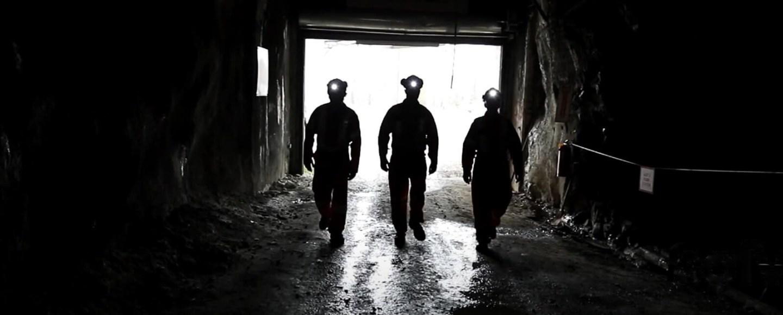 Three workers head into an underground mine. Image: Sofvie Inc.