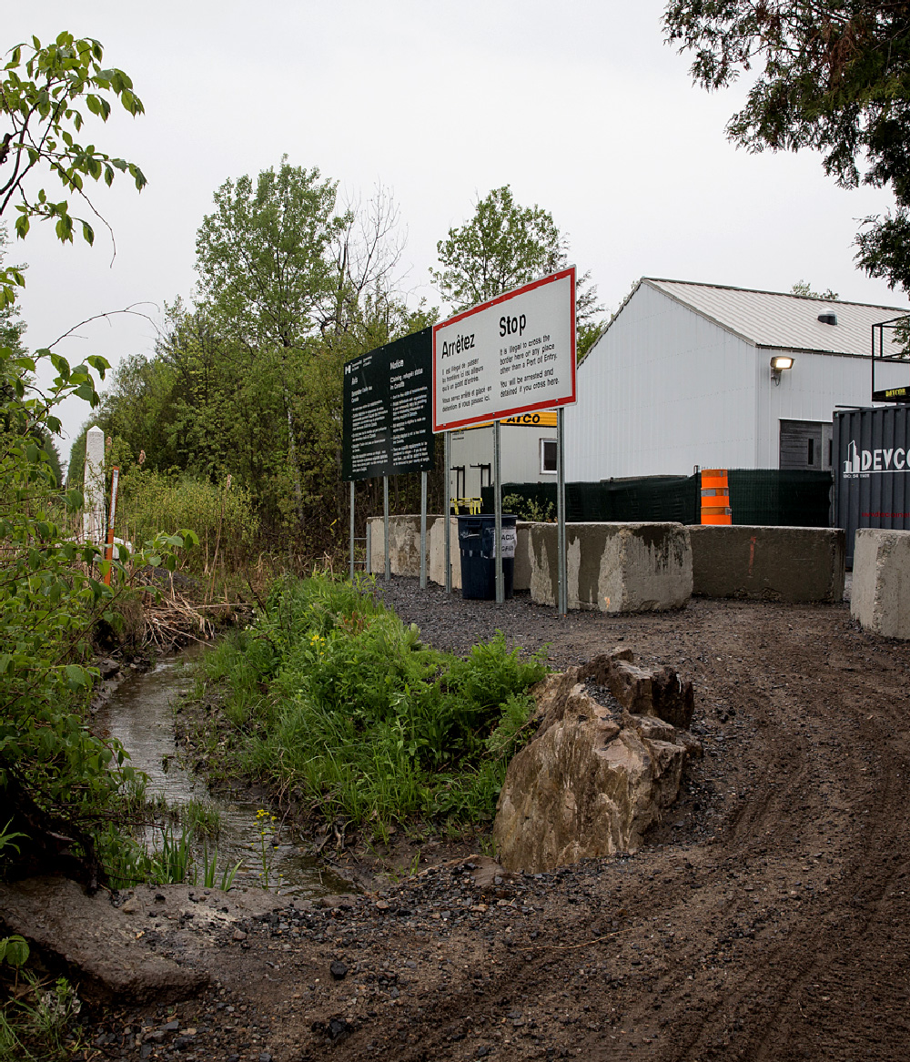 The border crossing between the U.S. and Canada near Champlain, NY. Following Donald Trump's eleciton, the number of migrants crossing over the small, wooded creek jumped to thousands each month. Canadian Border Services have since set up a detainment facility at the crossing point.(Scott Heins)