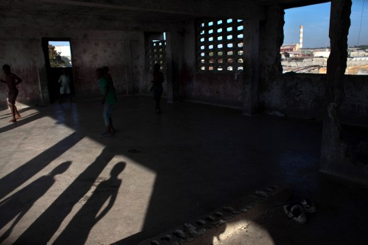 "PORT-AU-PRINCE, HAITI - JANUARY 27:  Boys play in the ruins of a building on the site of the Fort Dimanche prison, where many were held in inhumane conditions under the regime of Jean-Claude ""Baby Doc"" Duvalier January 27, 2011 in Port-au-Prince, Haiti.  The area is now a residential neighborhood called ""Democracy Village"". Duvalier returned from exile earlier this month and was questioned by authorities before being released. His critics accuse him of stealing from the treasury during his rule and for crimes against humanity.  (Photo by Allison Shelley/Getty Images)"