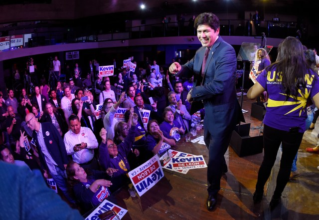 Kevin de Leon, state Senate president pro tem and Democratic candidate for the U.S. Senate, stands on stage after speaking during an election party Tuesday, June 5, 2018, in Los Angeles. (AP Photo/Mark J. Terrill)